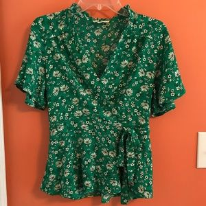 Green and white floral peplum top